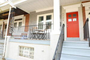 rowhome exterior with red door